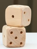 Dice. Two wooden dice on a white table royalty free stock image