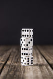 Dice on Vintage Wood Table Background stock image
