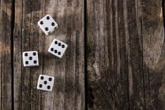 Dice on Vintage Wood Table Background royalty free stock image