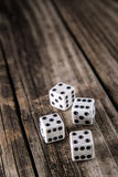 Dice on Vintage Wood Table Background Royalty Free Stock Images