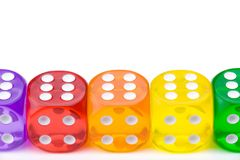 Dice in vivid colors isolated in pure white. Stock Photos