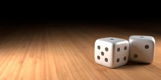 Dice On Wood With Black Fading In The Back. A close up of two dice on a wooden surface off to the right side, with black fading in the background, and a soft Stock Photos