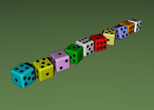 Dice wood, colored. In green background Royalty Free Stock Image