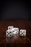 Dice on Wood Table Background Royalty Free Stock Image