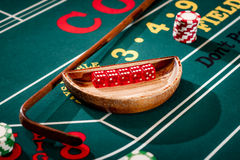 5 dice in a wooden bowl on a Craps Royalty Free Stock Photography