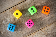 Dice on the  wooden floor Stock Photo