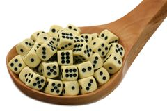 Dice in a wooden spoon Stock Image