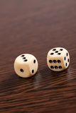 Dice on wooden table Stock Photography