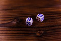 Dice on a wooden table. Gamble concept. Dice on a rustic wooden table. Gamble concept royalty free stock photography