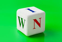 Dice with word Win. Concept background Royalty Free Stock Photo
