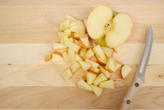 Diced Apples. On a cutting board royalty free stock photos