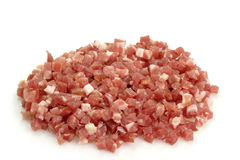 Diced bacon. Smoked diced bacon on bright background stock images