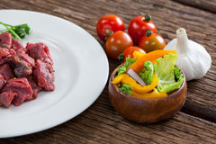 Diced beef and ingredients. Against black background Royalty Free Stock Photo
