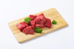 Diced beef. Raw diced beef on cutting board Royalty Free Stock Image