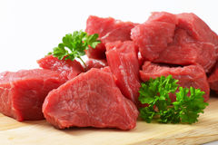 Diced beef. Raw diced beef on cutting board Stock Photography
