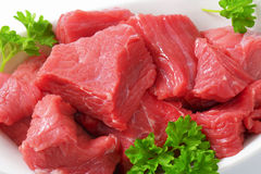 Diced beef. Raw diced beef on cutting board Stock Image