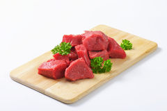 Diced beef. Raw diced beef on cutting board Royalty Free Stock Photo