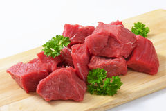 Diced beef. Raw diced beef on cutting board Royalty Free Stock Photos