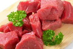 Diced beef. Raw diced beef on cutting board Royalty Free Stock Photography