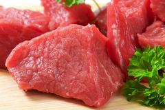 Diced beef. Raw diced beef on cutting board Royalty Free Stock Images