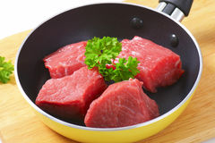 Diced beef. Raw diced beef in a pan Stock Images