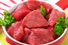 Diced beef. Raw diced beef in a pan Stock Image