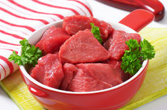 Diced beef. Raw diced beef in a pan Royalty Free Stock Image