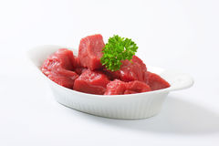 Diced beef. Raw diced beef in a  porcelain bowl Royalty Free Stock Photography