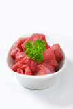 Diced beef. Raw diced beef in a  porcelain bowl Royalty Free Stock Image