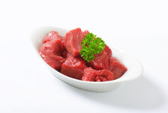 Diced beef. Raw diced beef in a  porcelain bowl Stock Photos