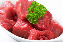 Diced beef. Raw diced beef in a  porcelain bowl Royalty Free Stock Photos