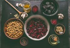 Diced beet and salad ingredients with pine nuts, chickpeas and prunes on dark background, top view with copy space for your design stock photo