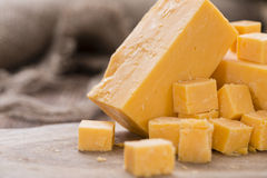 Diced Cheddar (on wood) Royalty Free Stock Photo