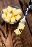 Diced Cheese on a fork Royalty Free Stock Photos