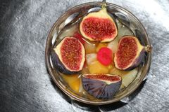 Diced fruit bowl with figs cut in half Stock Photos