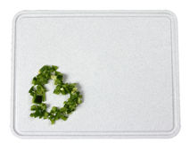 Diced Green Peppers on Cutting Board Stock Images