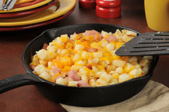 Diced ham and potatoes with cheddar cheese stock photos