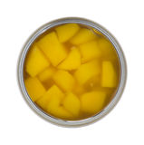 Diced Mangos In Can. A top view of an opened can of mangos on a white background Royalty Free Stock Photo