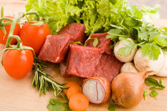 Diced meat with vegetables Stock Photos