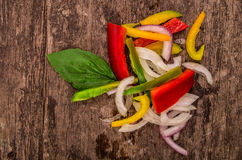 Diced peppers on a wood backgroiund. Peppers on a wood backgroiund stock photo