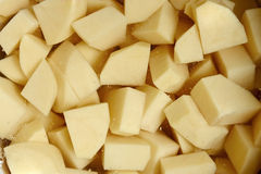The diced potato tubers in water Stock Images