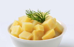Diced potatoes. Bowl of diced potatoes with fresh butter royalty free stock photos