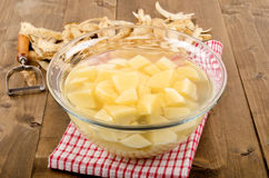 Diced potatoes in a glass bowl with water Royalty Free Stock Photos