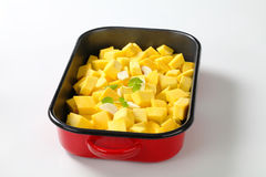 Diced pumpkin in a baking pan Royalty Free Stock Images