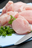 Diced raw chicken pieces Stock Photos