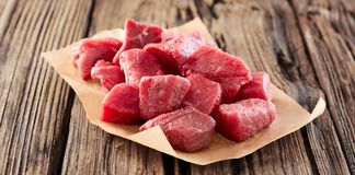 Diced raw fresh meat for goulash or stew stock photography
