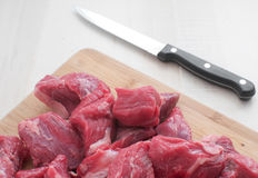 Diced raw meat and a knife Stock Photos
