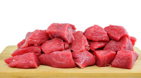Diced raw meat on wooden board isolated Royalty Free Stock Photo
