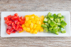 Diced Red, Green & Yellow Pepper. Diced Red, Green & Yellow Pepper together in white plate Stock Image