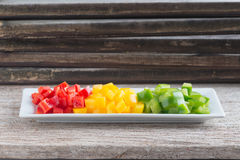 Diced Red, Green & Yellow Pepper. Diced Red, Green & Yellow Pepper together in white plate Royalty Free Stock Photography